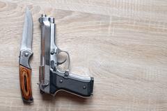 Silver metallic pistol with knife Kuvituskuvat