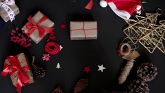 Top View Hands Wrapping Christmas Presents on Black Background From Above. Gift Stock Footage