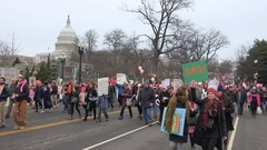 Waves of marchers arriving, Capitol in b.g., Women's March on Washington Stock Footage