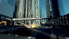 Urban traffic in the business district with glass facade skyscrapers. Stock Footage