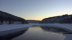 4k Frozen dam lake Harz Okertalsperre time-lapse with airplane chemtrails Stock Footage