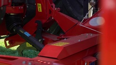 Small parts on the grass cutting machine are moving Stock Footage