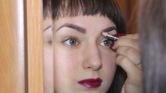 Woman Paints her brows Stock Footage