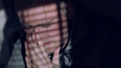 Close-up of man's face in the harsh lighting. Hard day many thoughts. Sunny day Stock Footage