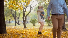 Angry father leaving wife and baby at park after family conflict Stock Footage