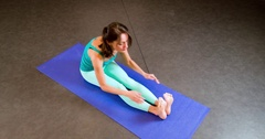 Woman doing yoga exercise 4k top view video. Girl sits mat stretches posture Stock Footage