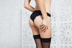 Beautiful ass of a young girl in black underwear Stock Photos