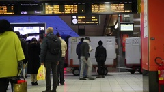 Passengers in the train station, with train stopped at the platform Stock Footage