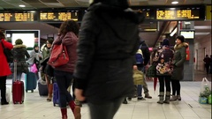 Passengers in the train station, waiting for the arrival of the train at th.. Stock Footage