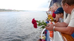 The ship's passengers on deck with flowers Stock Footage