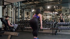 Fitness peoples doing exercise 4k gym video. Woman deadlift with barbells Stock Footage