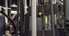 Weight stack plates cable exercise machine 4k close-up video. Gym equipment Stock Footage