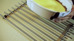Cooking casserole. Female hands putting on the table prepared baked pudding. HD Stock Footage