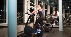 Woman cardio gym training 4k close-up video. Fitness girl on stationary bicycle Stock Footage