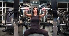 Fitness woman doing push weight chest exercise 4k gym video. Exercise machine Stock Footage