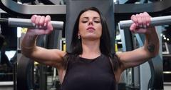 Fitness woman doing push weight exercise 4k gym video Chest workout machine Stock Footage