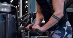 Man doing arms weight exercise 4k gym video. Training triceps on cable machine Stock Footage