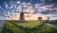 Windmill at sunrise in Netherlands. Beautiful old dutch windmill Stock Photos