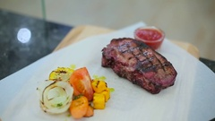 Presentation of steak with vegetables Stock Footage