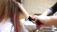 Hairdresser makes hair straightening, barber makes new woman haircut, woman Stock Footage