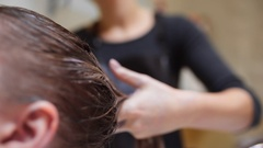 Hairdresser does hair coloring in beauty studio, woman changes her look Stock Footage