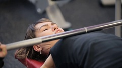 Paurlifting. The sports woman. Gym. The woman lifts heavy weight lying on a back Stock Footage