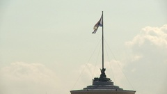 Russian flag flutters in the wind on the flagpole on blue sky background Stock Footage