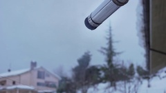 Slow motion of heating exhaust pipe of a house covered in snow. Stock Footage