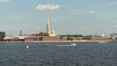 Boats floating on the river Neva on a background of Peter and Paul Fortress Stock Footage
