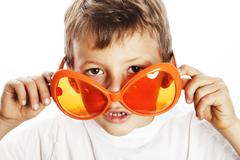 Little cute boy in orange sunglasses pointing isolated close up Stock Photos