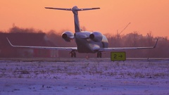 Plane getting ready to take off and accelerate. Winter sunset Stock Footage