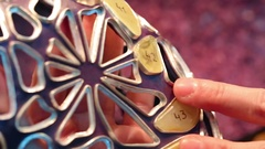 Jeweler fixes amber rocks on the workpiece. close-up Stock Footage