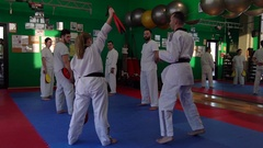 1020 Slow motion video of adult taekwondo training session in the gym, coac.. Stock Footage
