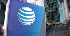 Street signage board with American Telephone and Telegraph Company ATT logo Stock Footage