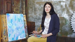 Young woman artist draw pictrure with watercolor paints and smile looking into Stock Footage