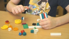 Child playing intellectual game with the designer Stock Footage