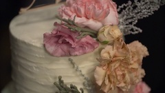 Rich white wedding cake decorated with pink and beige flowers Stock Footage
