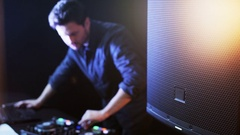 DJ Standing and Using DJ Console Stock Footage
