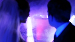 The Young Couple in a Nightclub Looking at the DJ Stock Footage