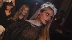 Girls in halloween zombie vampire costumes dancing and goofing at club party Stock Footage
