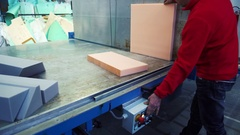A man cutting foam rubber on the huge cutting machine, 4K Stock Footage