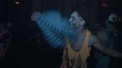 Two guys in zombie makeup dancing in crowd at halloween night club party Stock Footage
