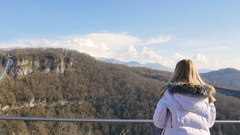 Skybridge observation deck. Woman enjoing sunlight and scenery view of the Stock Footage