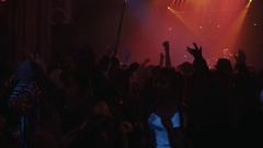 People in halloween costumes dance at party in night club, flashing lights Stock Footage