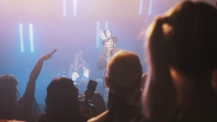 Host in mad hatter costume talk to crowd in night clup at halloween party Stock Footage
