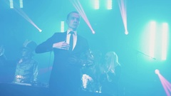 Man in suit and mechanical arm robot dance at night club scene halloween party Stock Footage