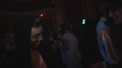 Guy in hood with blood on face jokingly attacks camera at halloween party Stock Footage
