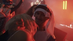 Guy in arabian costume kisses blonde girl in Cleopatra suit at halloween party Stock Footage