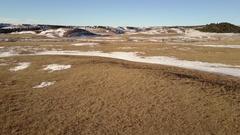 Aerial of Vast Great Plains Winter Snow Herd of Pronghorn Antelope Stock Footage