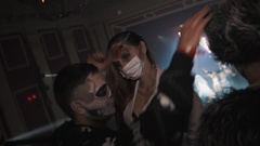 Group of young people in halloween costumes dancing for camera at night club Stock Footage